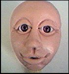 Head with eyelids added.